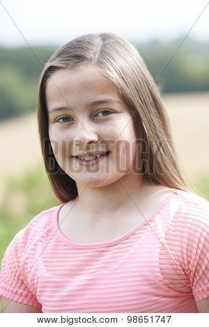 Outdoor Head And Shoulders Portrait Of Girl