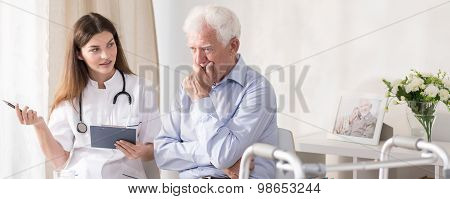 Patient Talking With Young Doctor