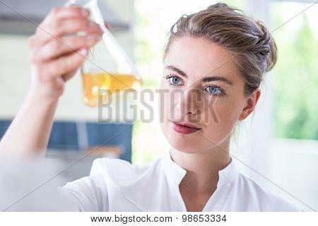 Female Chemist Holding Flask