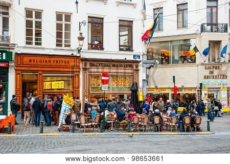 People Eating Traditional Belgian Frites In Brussels