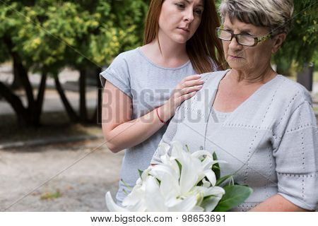 Caring Granddaughter Supporting Her Grandma