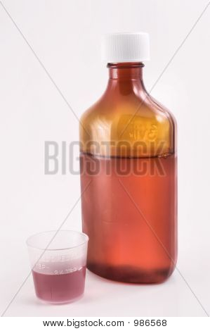 Cough Syrup And Measuring Cup