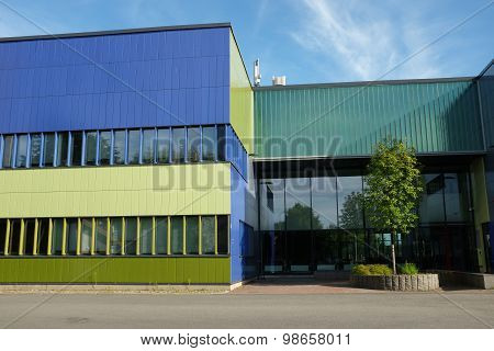 Modern Building With Blue And Green Color Wall