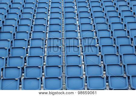 Plastic Blue Seats On Football Stadium Background