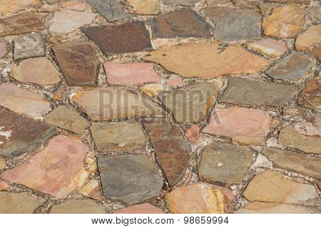 Track From Textured Brown And Pink Sandstone
