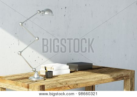 Wooden desk with lamp at home as workspace in front of concrete wall (3D Rendering)