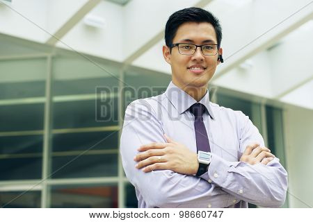 Business Man With Smartwatch And Wireless Handsfree Device