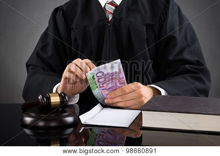 Judge Counting Euro Banknote