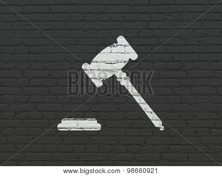 Law concept: Gavel on wall background
