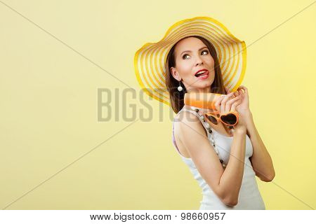 Woman In Summer Hat Holds Sun glasses Sunscreen Lotion