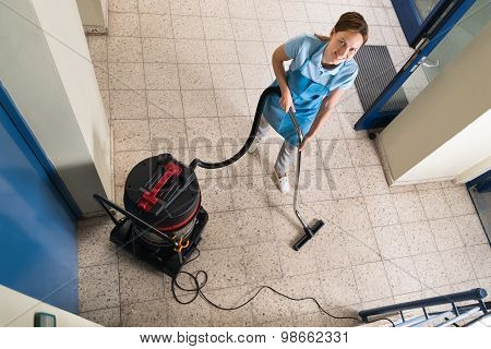 Janitor Vacuuming Floor