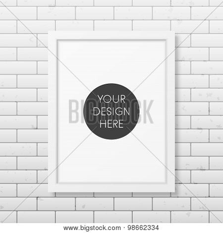 Realistic white frame A4 on the brick wall background