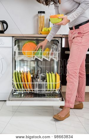 Woman Removing Bowls From Dishwasher