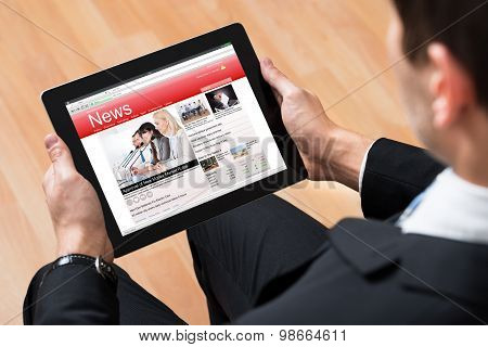 Businessperson Reading News Online