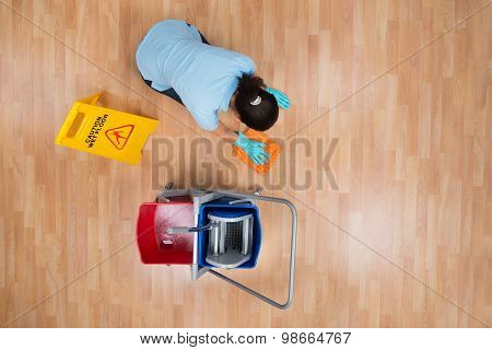 Woman Cleaning Floor With Rag