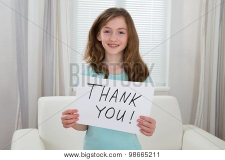 Girl Holding Board With The Text Thank You