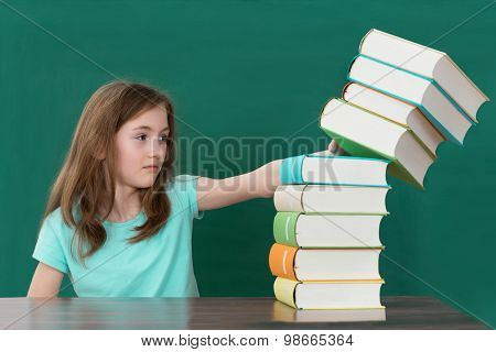 Student Pushing Stack Of Books