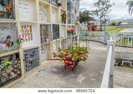 Cemetary San Diego church Quito showing typical catholic tomb graves outdoors with flowers decorated