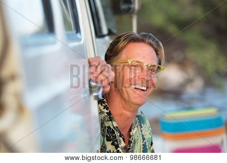 Laughing Man Sitting In Van