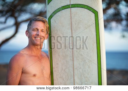 Handsome Surfer With Surfboard
