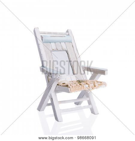 Rustic nautical deck chair on a white background with drop shadow