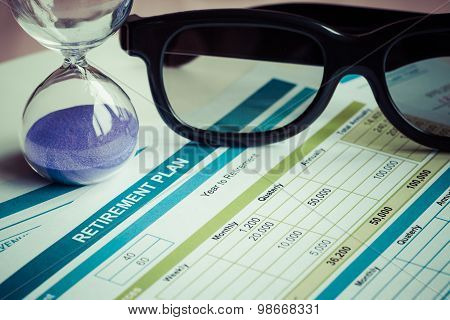Retirement Planning With Glasses And Hourglass, Business Concept