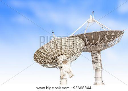 Satellite Dish Antenna Radar Big Size Isolated On Blue Sky Background
