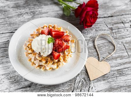 Waffles With Strawberries And Vanilla Ice Cream, Red Rose And Paper Heart On A Light Wooden Backgrou