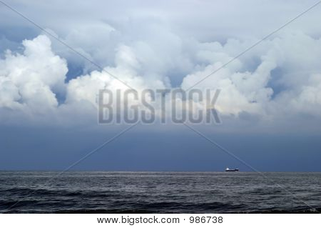 Little Ship On Cloudy Background