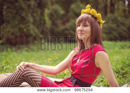 Portrait of beautiful young woman in red dress with dandelion wr