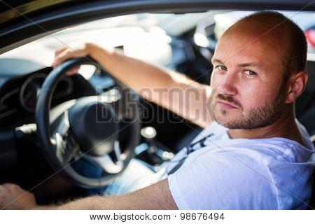 Portrait of a man inside his car