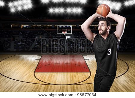 Basketball Player on a black uniform in basketball court