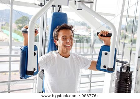 Man At The Gym Exercising