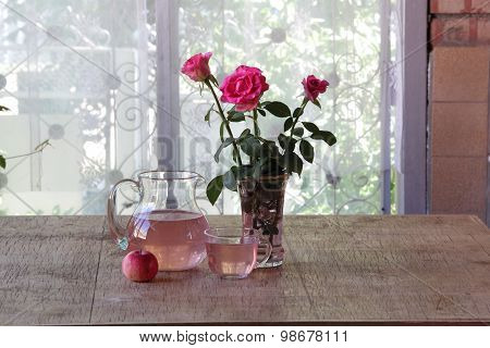 Apple Compote In A Transparent Jug, A Bouquet From Roses And Fresh Apples