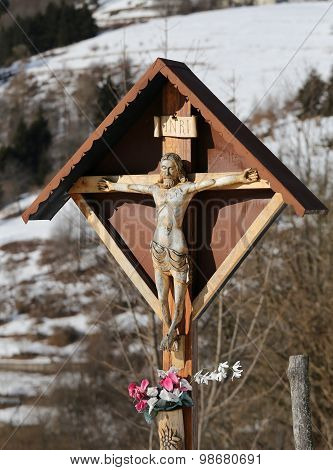 Wood Crucifix With Capitellum In A District Of A Mountain Village