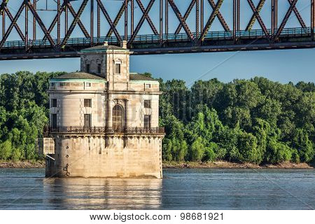 Historic water intake tower number 2 built in 1915 and the Old Chain of Rocks bridge on the Mississippi River near St Louis
