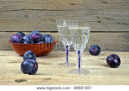 Two Glasses Of Plum Brandy With Plums