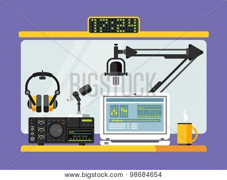 Professional radio station studio with microphones and headphones