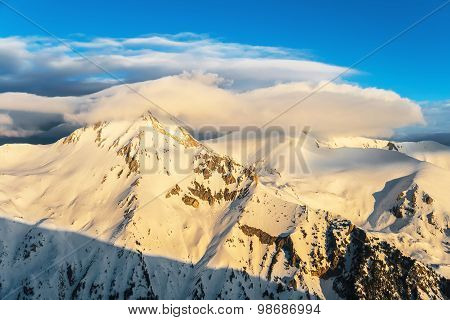 Winter Snowy Mountain Ridge at Sunrise