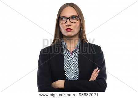 Thinking businesswoman in glasses with arms crossed