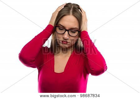 Image of woman holding her head