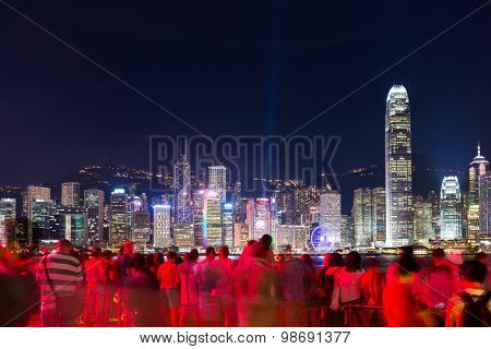 Many people watching the light show in Hong Kong at night