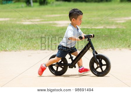 Little boy play with bicycle