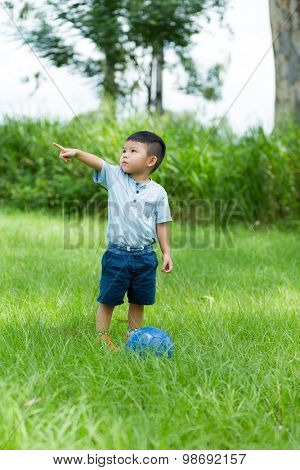 Little boy playing soccer at outdoor