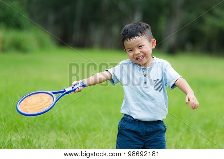 Thrilled Little kid play with tennis