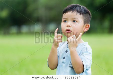 Small kid with two finger hold up