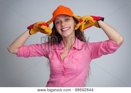 Woman Wering Baseball Cap And Construction Gloves