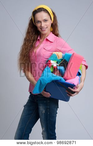 Cheerful Woman Holding Different Cleaning Stuff