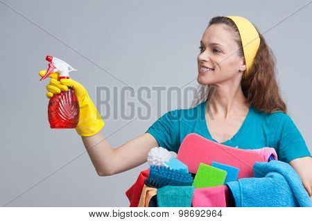 Woman Holding Different Cleaning Stuff