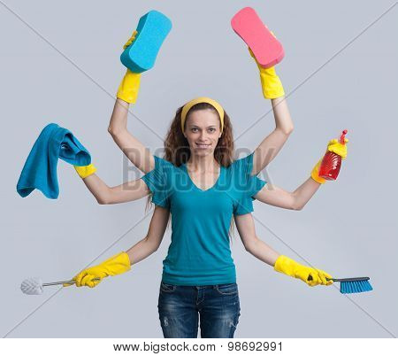 Woman In A Domestic Role Multitasking Her Cleaning